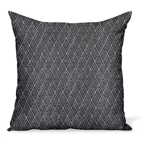 A decorative pillow or cushion made from Peter Dunham Textiles linen tribal print, Atlas in Charcoal