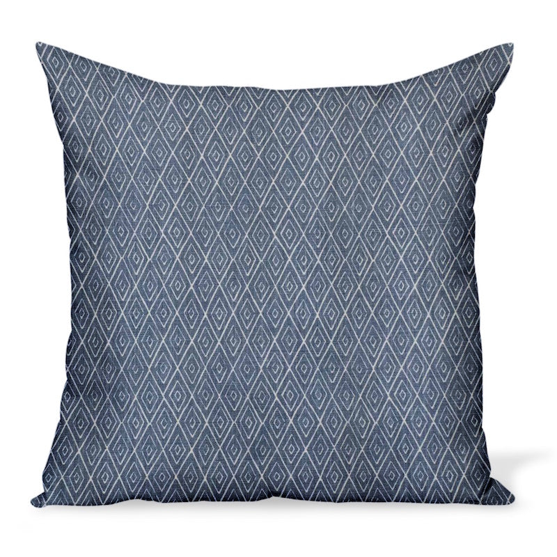 A decorative pillow or cushion made from Peter Dunham Textiles linen tribal print, Atlas in indigo blue