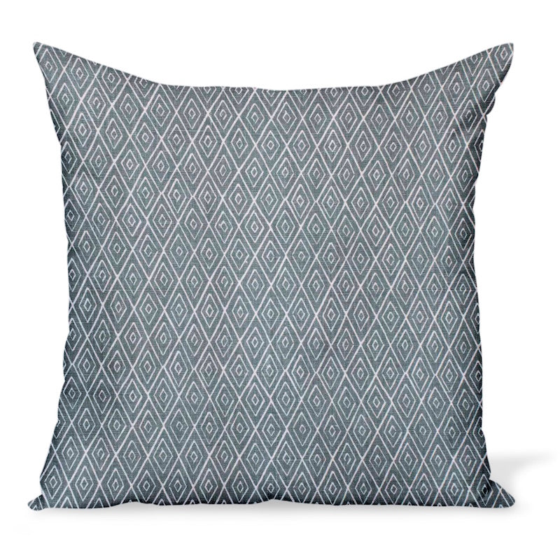 A decorative pillow or cushion made from Peter Dunham Textiles linen tribal print, Atlas in Ocean, a blue/green.