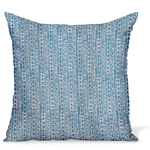 A decorative pillow or cushion made from Peter Dunham Textiles linen tribal print, Char in Indigo