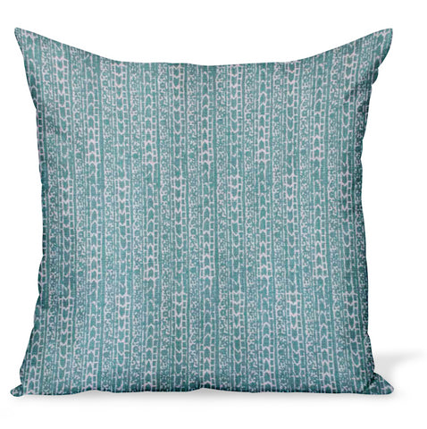 A decorative pillow or cushion made from Peter Dunham Textiles linen tribal print, Char in Nile, a pretty green