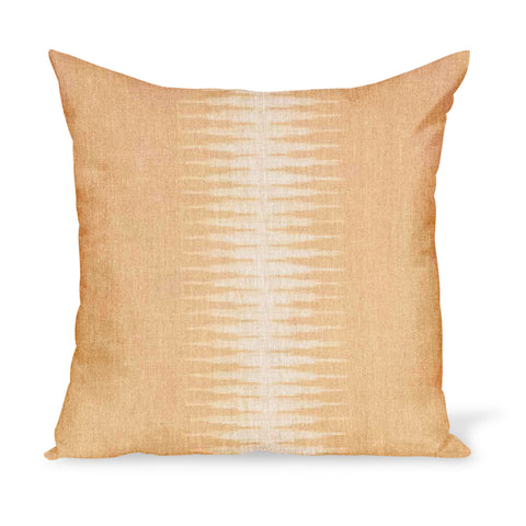 A linen pillow made from a modern take on Ikat in a golden colorway, by Peter Dunham Textiles