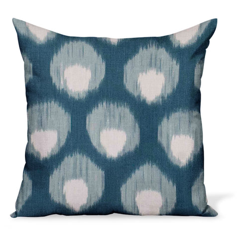 A decorative pillow or cushion made from Peter Dunham Textiles linen tribal print, Bukhara in Blue