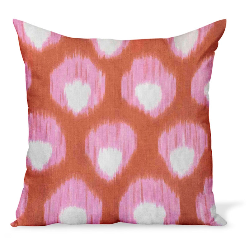 A decorative pillow or cushion made from Peter Dunham Textiles linen tribal print, Bukhara in pink and orange