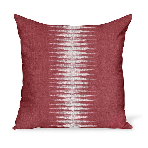 A linen pillow made from a modern take on Ikat in Pomegranate, a red colorway, by Peter Dunham Textiles