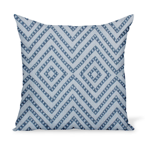 A pillow or cushion made from Peter Dunham Textiles Mansa fabric, a tribal indoor or outdoor woven with Sunbrella yarns