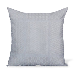 A pillow or cushion made from Peter Dunham Textiles Nawab fabric, a tribal indoor or outdoor woven with Sunbrella yarns