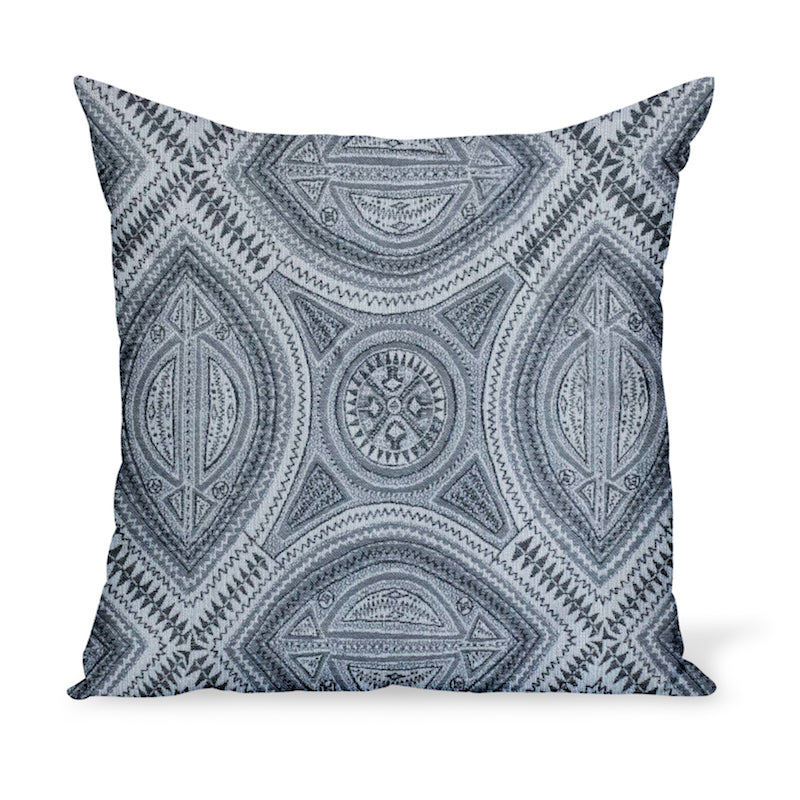 A pillow or cushion made from Peter Dunham Textiles Sahara fabric, a tribal indoor or outdoor woven with Sunbrella yarns