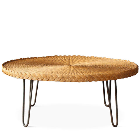 The San Remo Coffee Table features a circular wicker top with mid-century styled hairpin iron legs in a rustic patina. The table is completely handmade in Los Angeles and designed by Hollywood at Home founder Peter Dunham.