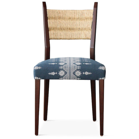 Our Silverlake side chair, designed by Hollywood at Home founder Peter Duhham, is handmade in Los Angeles with a solid oak frame, a handwoven rush back, and an upholstered seat. The dining chair adds vintage style to a dining area.