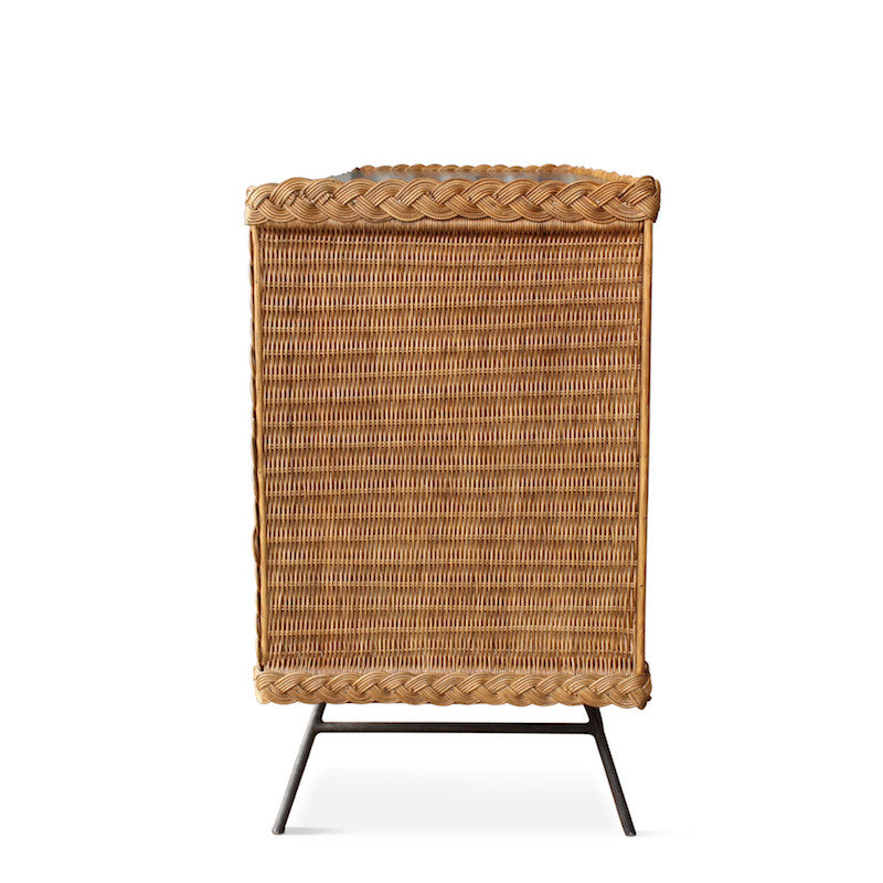 Our wonderful Wicker Credenza is the perfect casual yet chic addition to your living space. It's handmade in Los Angeles and features an iron base, wicker body, braided wicker edges, and a wood top.