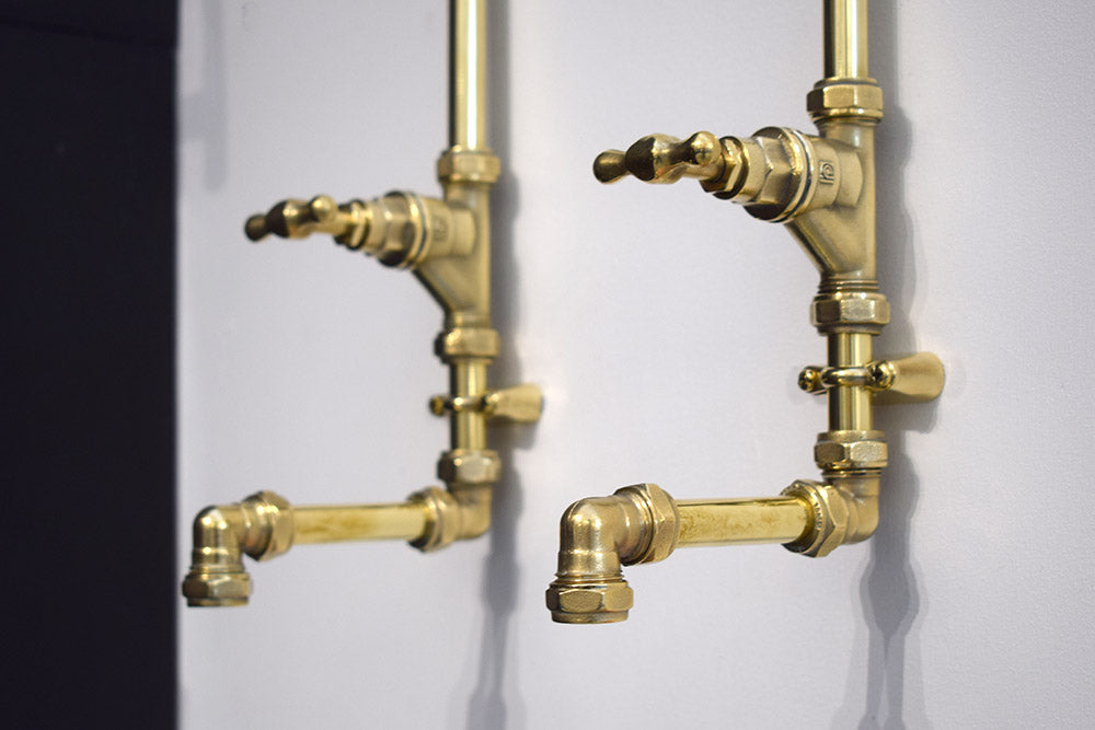 brass wall mounted taps made by Proper Copper Design