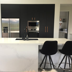 A beautiful modern matt black and copper kitchen theme fitted with our copper pull handles