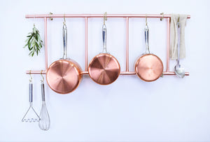 Copper pot and pans featured on our stylish copper pot and pan wall rack