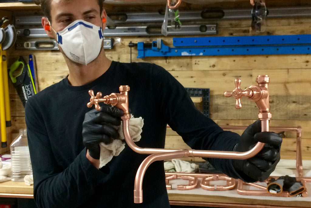 Proper Copper Design Managing Director, Khan, with Copper Tap