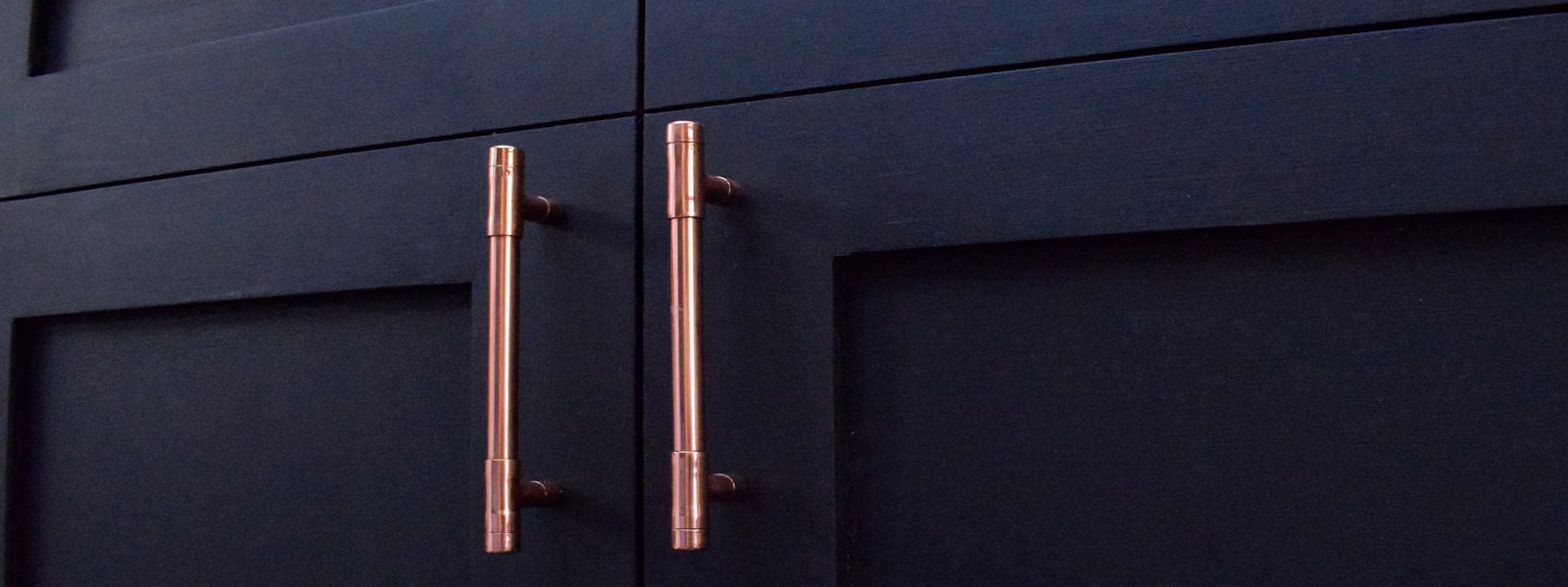 copper handles on cabinets