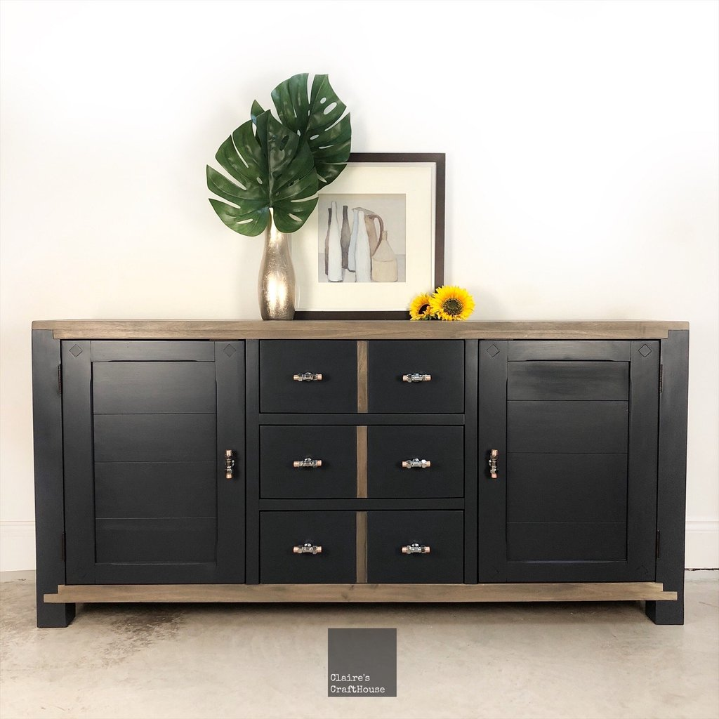 dark cabinet with chrome knobs