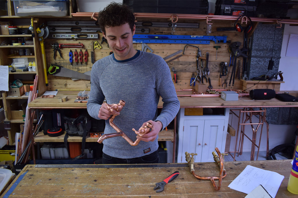 Proper Copper Design Founder Khan Erkeksoy holding Copper Tap