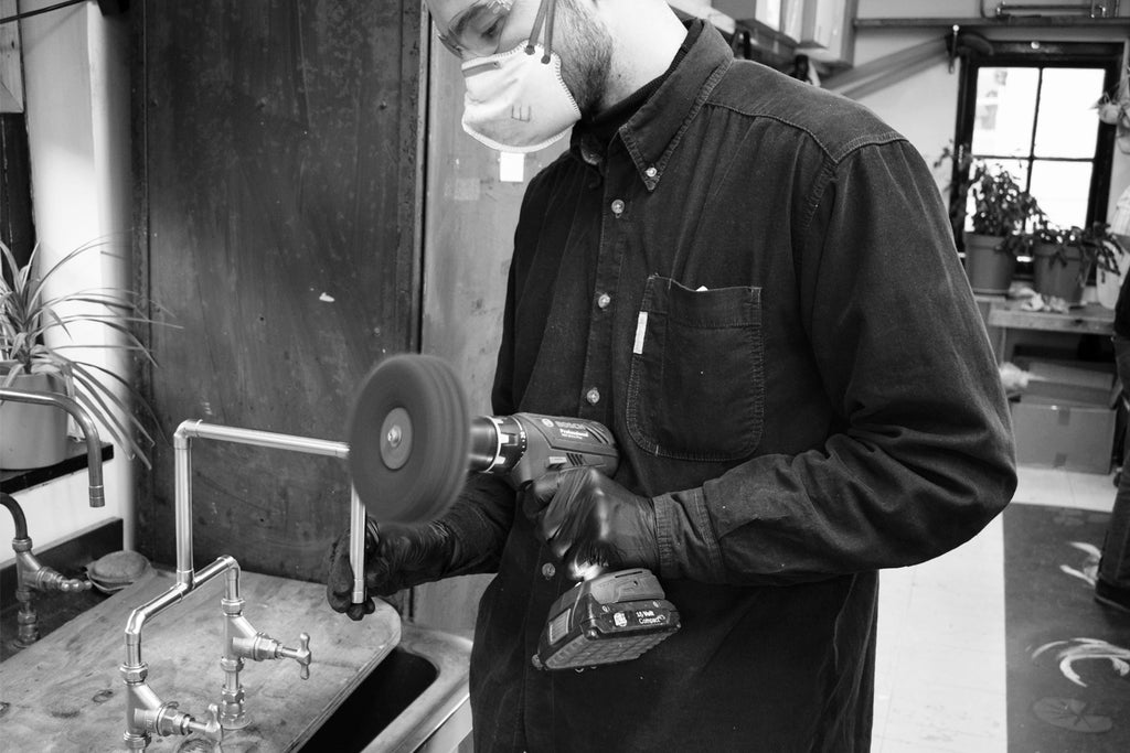 Proper Copper Design Production Manager, Ed Moriarty, Polishing a Bespoke Copper Tap
