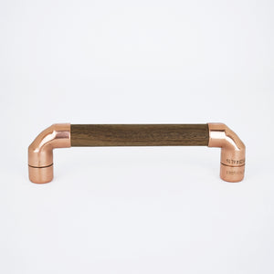 walnut wood and copper pull handle for drawers and units