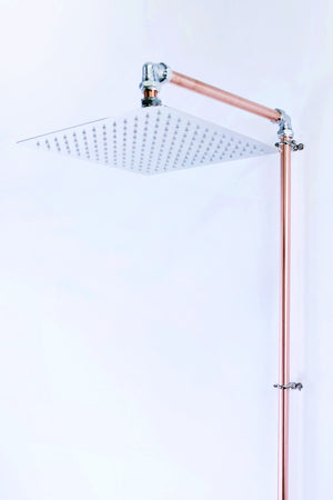 copper-chrome-shower-showers-rainfall-propercopper-madeintheuk-industrial-designer-luxurious-designer-highend-london-exposed-wall mounted
