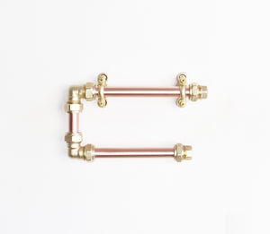 copper and brass minimal industrial functional practical toilet paper tissue holder design