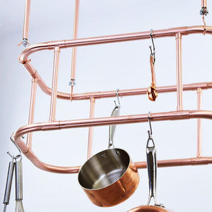 Curved Copper Ceiling Rack for Kitchen Pot and Pan Storage Solution minimal industrial fashion