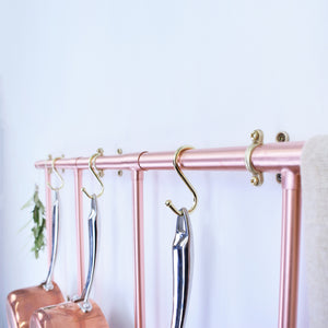 minimal industrial wall ladder rack made from copper