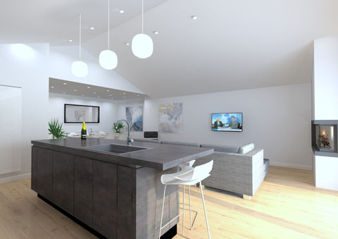 open plan kitchen with couch and tv in the background