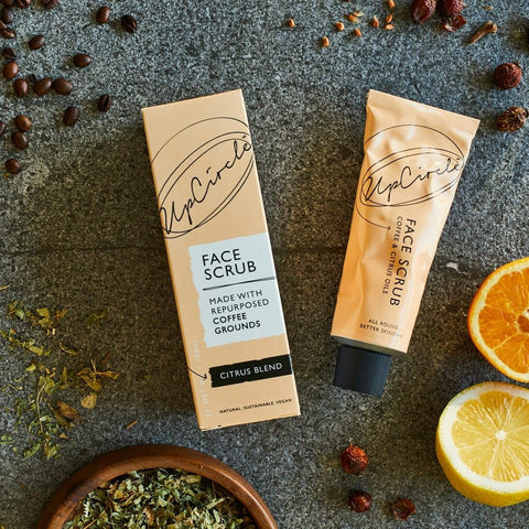 coffee face scrub tube next to packaging box