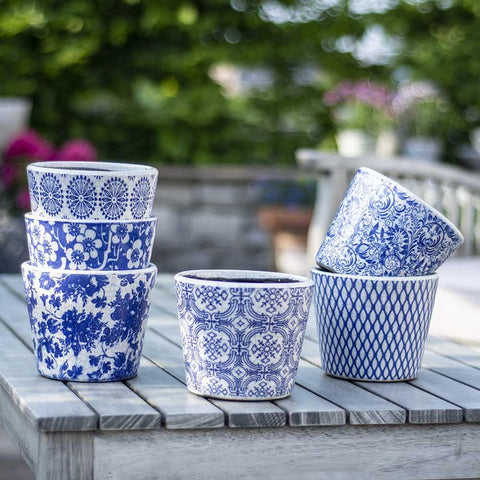 blue patterned plant pots stacked