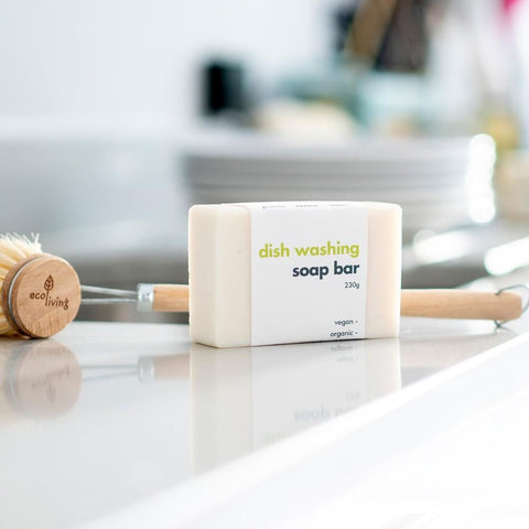 bar of dish washing soap on a counter with a dish brush