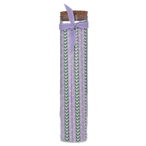 glass jar of lilac and green paper straws