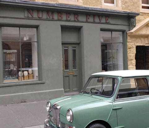 shop front of number five goldsmiths in perth scotland with retro mini parked infront