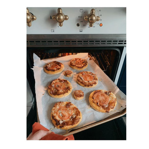 tray of savoury puff pastry tarts coming out of the range cooker oven