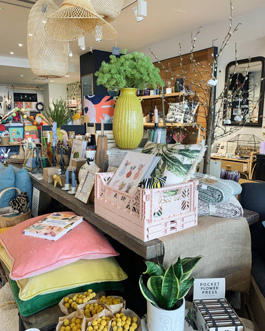 inside the quince and cook store, a table of products including gifts, homewares, books