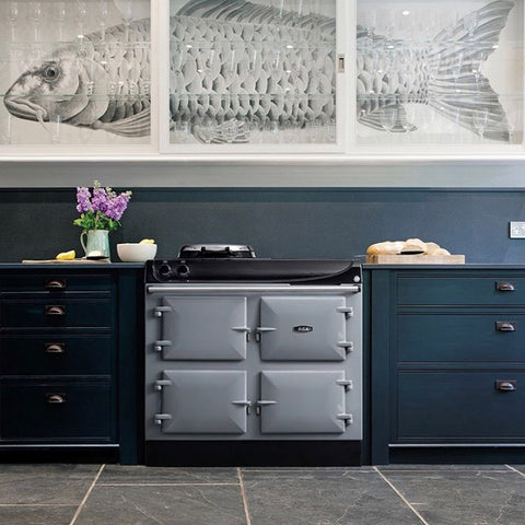 grey range cooker in a blue kitchen fish canvas on the wall
