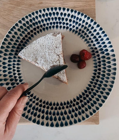 plate with a slice of gluten free raspberry and amaretto tart