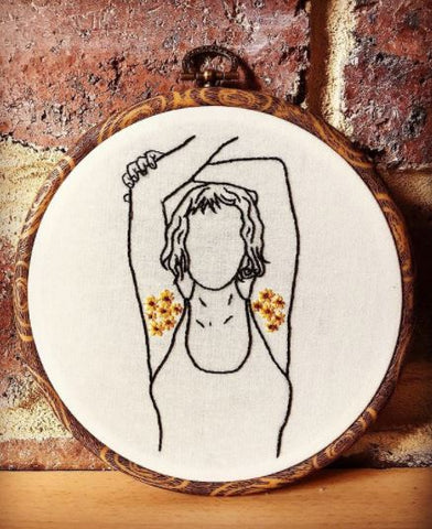 embroidery hoop with female figure outline