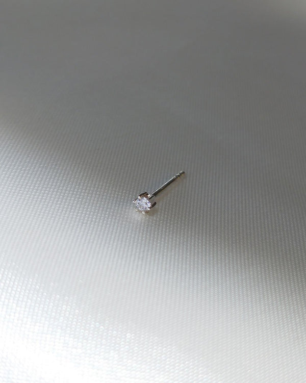 Crystal Droplet Stud (Sterling Silver) on a grey silk background by Sit & Wonder