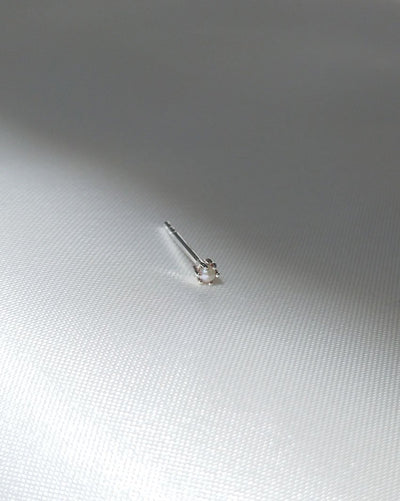 Pearl Droplet Stud (Sterling Silver) by Sit & Wonder on a grey silk background