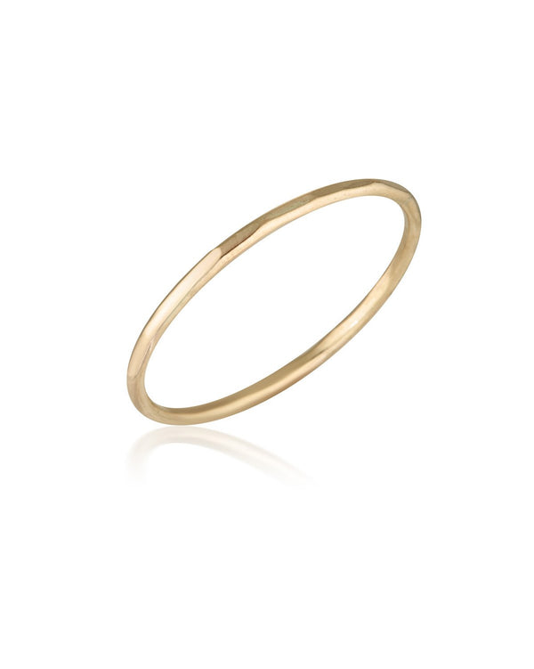 Journey Ring (9k Yellow Gold) by Sit & Wonder. A lightly hammered plain band.