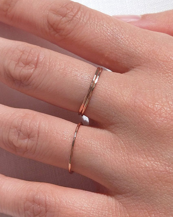 Whisper rings in rose gold by Sit & Wonder shown on a model's hand