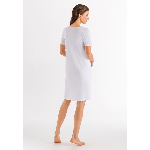 Model wearing white cotton short-sleeved nightdress from the Moments collection by Hanro of Switzerland