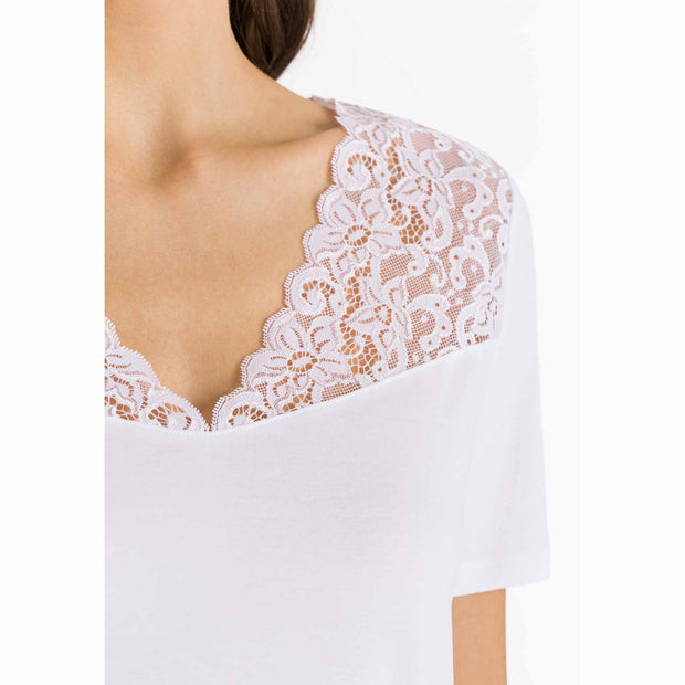 Close up of lace neckline on white short-sleeved soft cotton nightie from Hanro of Switzerland