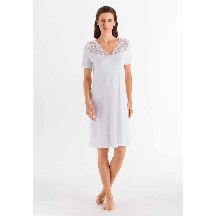 Model wearing white short-sleeved cotton nightie (077930) from Hanro of Switzerland