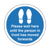 Please Wait Until Person In Front Has Moved Floor Sticker - Blue | Safety-Label.co.uk