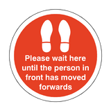 Please Wait Until Person In Front Has Moved Floor Sticker - Red | Safety-Label.co.uk