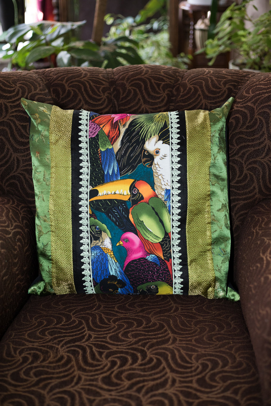 Tropical birds cushion in green