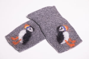Warm, comfortable and unique looking half-mittens, handmade of pure wool in Iceland. We use a blend of Scottish lambswool and merino wool for the knitted base for its wonderful softness and the coarser Icelandic wool for the hand felted pattern.